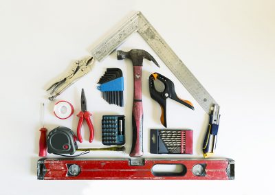 Home renovation concept. Shape of a house from construction tools.