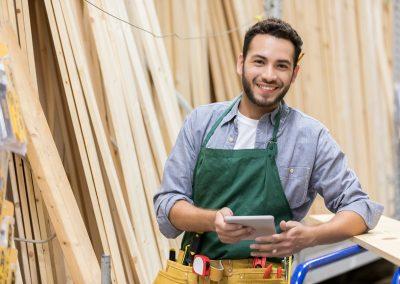 Portrait of confident lumber yard employee